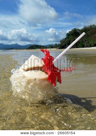 Coconut cocktail in the surf. Langkawi island, Malaysia