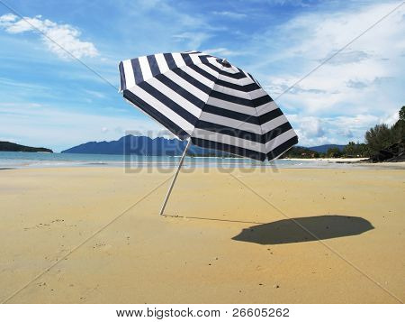 Striped umbrella on a sandy beach of Langkawi island