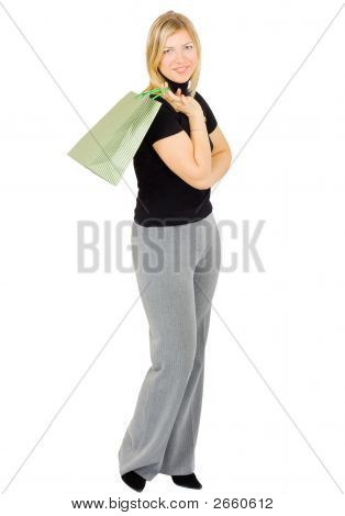 Portrait Of An Attractive Young Woman Holding Green Striped Shopping Bag