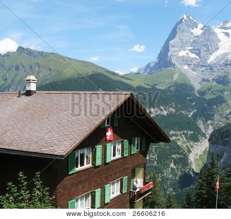 Traditional Swiss cottage against Eiger mountain in Jungfrau region