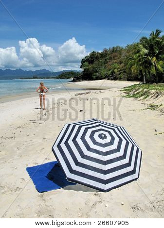 Young woman on a desert beach of Langkawi island, Malaysia