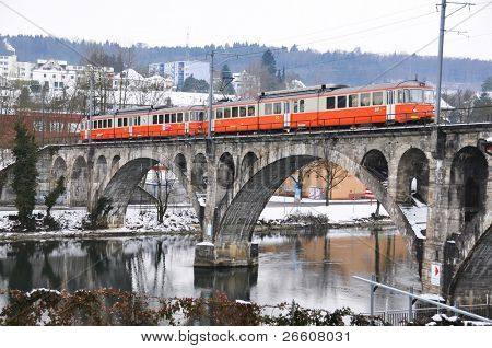 Train crossing ancient bridge
