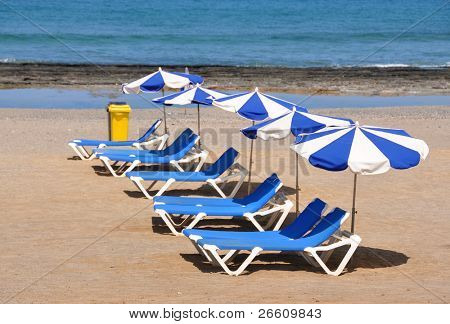 Sunbeds and umbrellas on the sandy beach of Tenerife island, Canaries