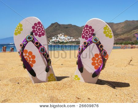Flip-flops in the sand of Teresitas beach. Tenerife island, Canaries