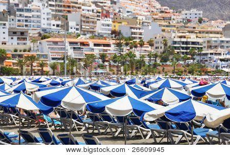 Umbrellas on the beach of Playa de las Americas. Tenerife, Canaries