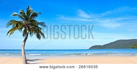 Panoramic tropical beach, blue sea and sky