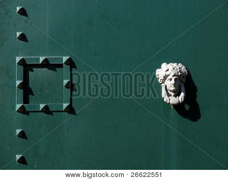 Door knocker with head of Medea and peephole