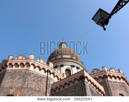 Randazzo the cupola and the apses of the church of Saint Nicolò and stree lamp
