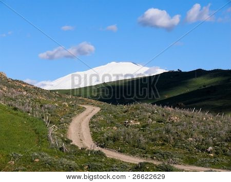 Rural road and landscape of the volcano Etna snow covered