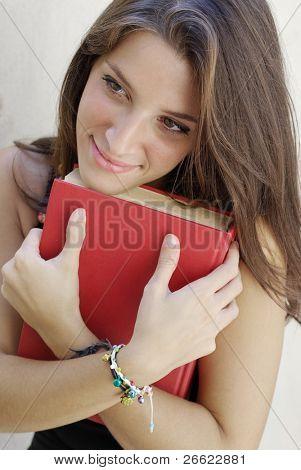 Girl student hug her book