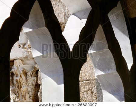 archs of arab window of the colonnade of the cathedral of Santo Andrea to Amalfi