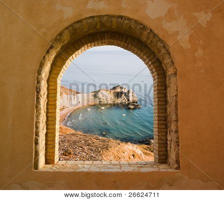 arched window on the coastal landscape of a bay