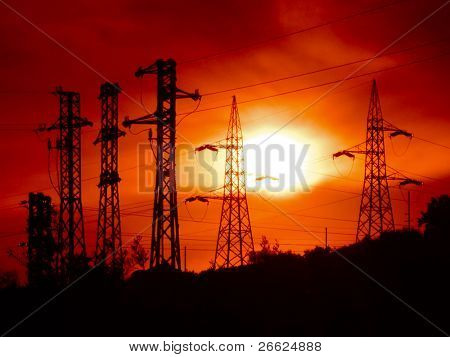 electricity pylons at the sunset
