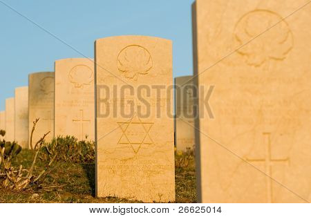 row of tombstone in cemetery war