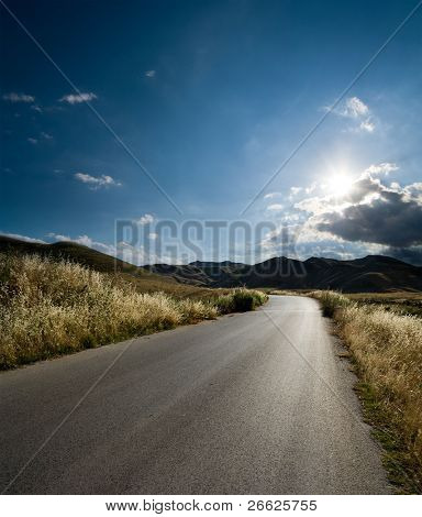 asphalt of country road in backlit