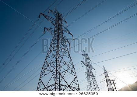 High voltage power lines at dusk.