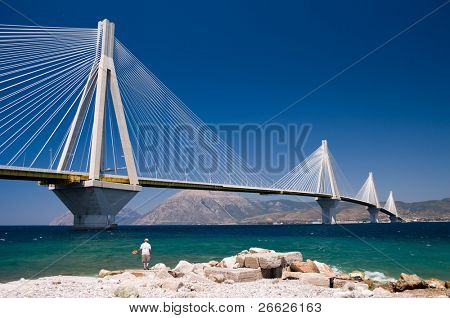 suspension bridge crossing Corinth Gulf strait, Greece.  The lead architect was Berdj Mikaelian. Is the world's second longest cable-stayed deck;