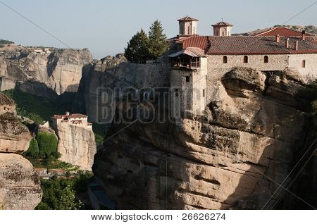 view of Moni of Varlaam and on background of moni Roussanou on cliff of Meteora, Greece
