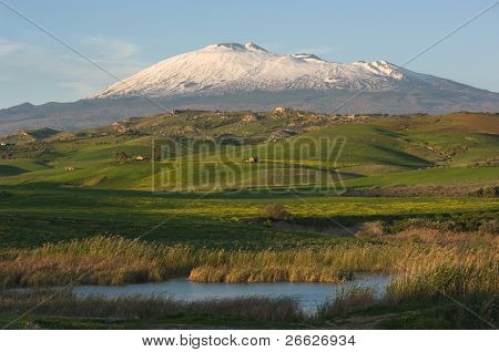 the majestic Etna dominates the green hills of the hinterland of Sicily