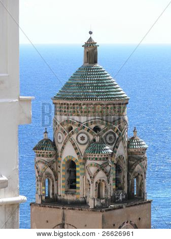 the bell tower of cathedral of Amalfi against blue sea