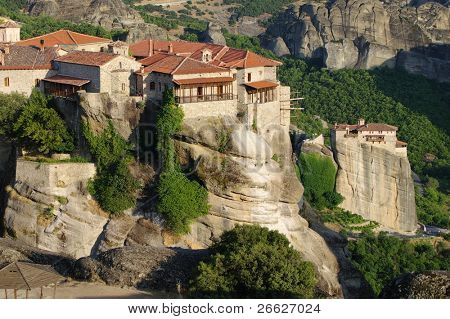 The Holy Monastery of Great Meteoron on background Moni Agias Varvaras Roussanou, Greece