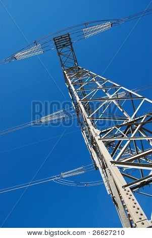 low angle view for electricity pylon against blue sky