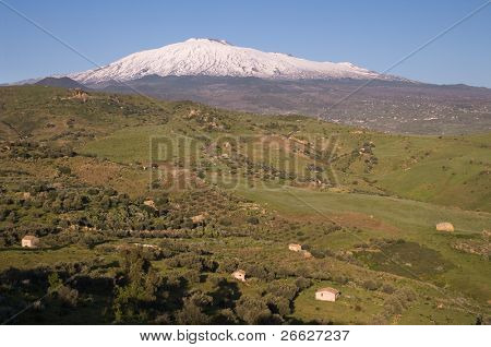 cultivated land in a beautiful valley of the sicilian hinterland under the majestic volcano Etna
