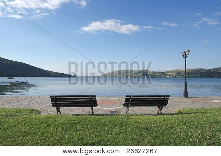 two benches with a view of a lake in the luminous landscape