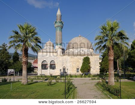mosque with tiled minaret in a garden with palm trees of Iznik the ancient Byzantine city of Council of Nicea, Turkey