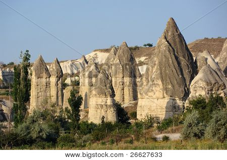 group of fairy chimneys typical rock formation in Goreme, Cappadocia - Turkey