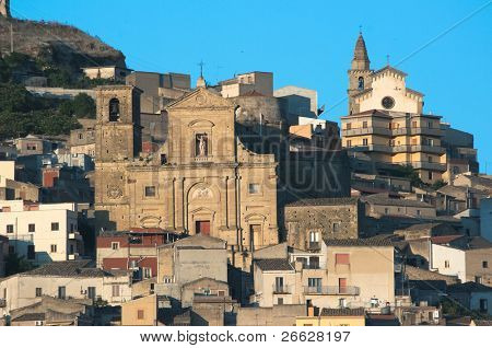 churches on the hill on which stands the village of Agira in Sicily