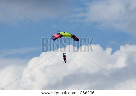 Skydiver In The Clouds