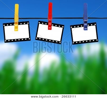 Blank film stripes hanged on peg