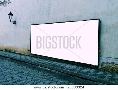Large blank billboard on a street wall