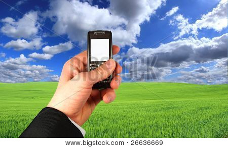 Businessman holding his mobile phone