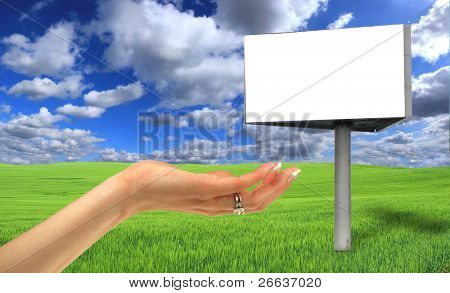 Blank billboard in beautiful landscape scenery with women hand
