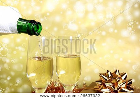 Golden theme of Pouring champagne wine into glasses