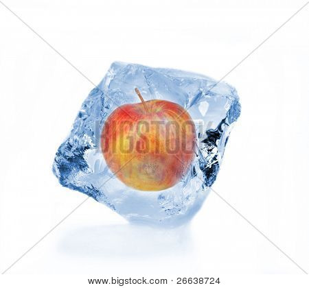 Red apple frozen in ice cube isolated on white background