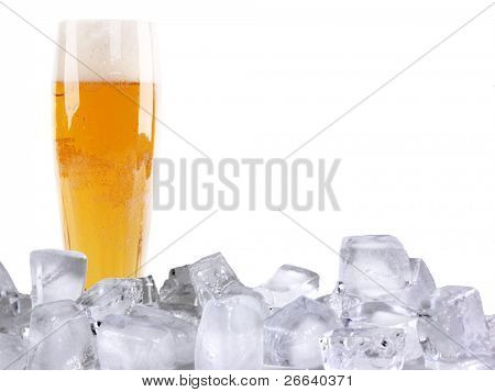 Glass of beer with ice cubes, isolated on white background
