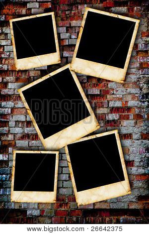 Vintage photo frames on old brick wall