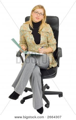 Businesswoman In A Chair With Paperwork