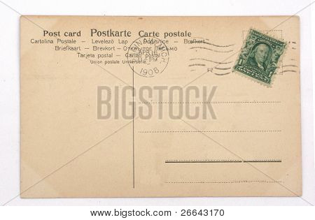 Back of a vintage postcard with a stamp