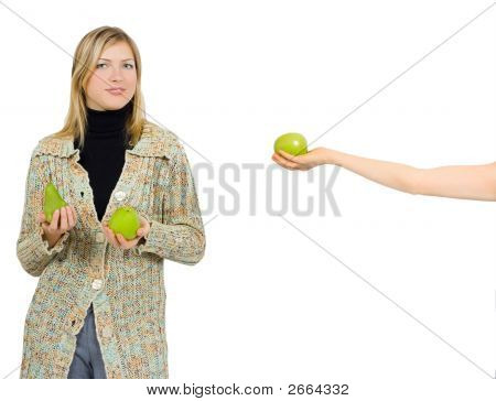 One Girl Gives An Apple To A Another Who Already Has An Apple And A Pear In Her Hands