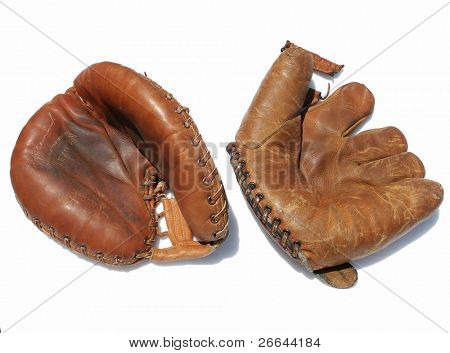 Used baseball mitten and gloves, isolated on white