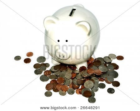 White piggy bank with loose change