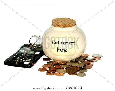 Retirement concept with a jar, checkbook, coins and glasses