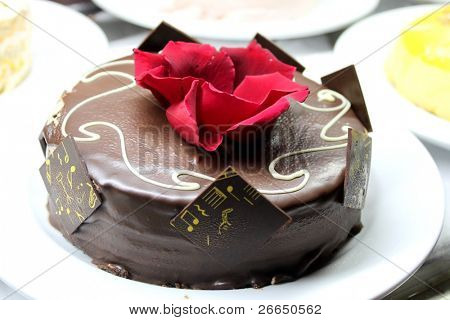 Triple chocolate cake with a red flower