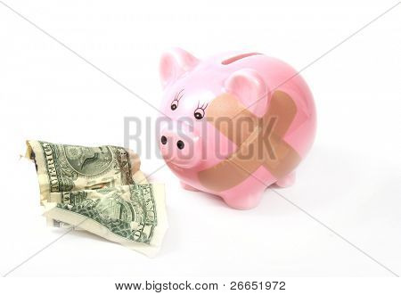 Hurt piggy bank with dollar