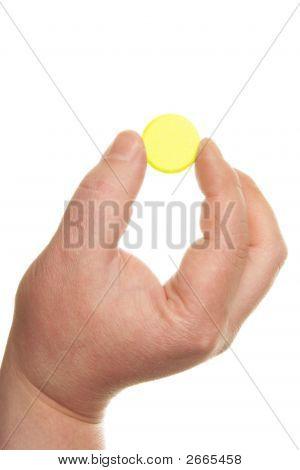 Mano comprimido amarillo