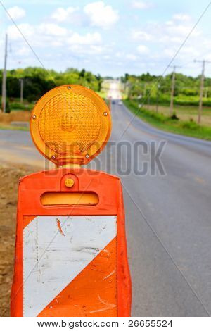 Traffic cone flasher on empty road